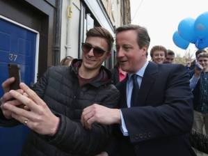 British Prime Minister David Cameron poses for a selfie