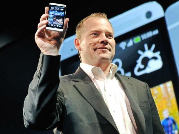 Jason Mackenzie presenting a HTC phone