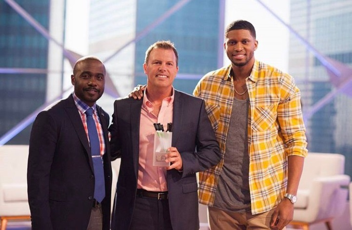 Erik Elfstrum (centre) with athletes Marshall Faulk (left) and Rudy Gay (right)